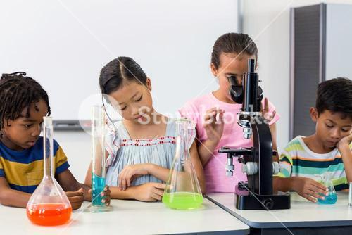 Children with scientific equipment