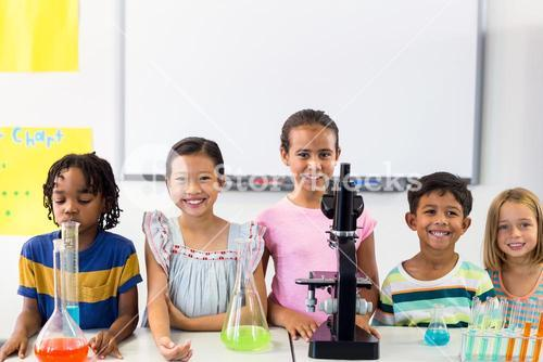 Children with scientific equipment in laboratory