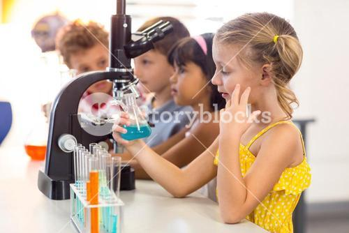 Girl looking at chemical