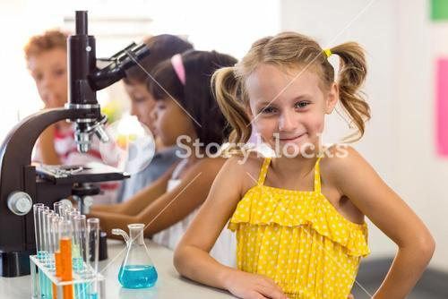 Girl with classmates in laboratory