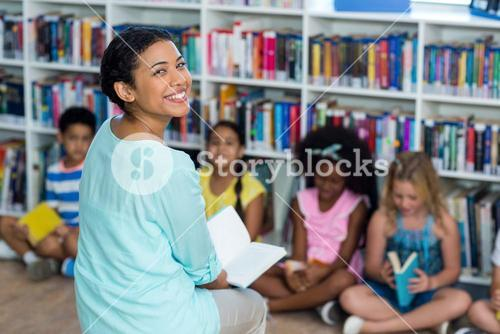 Happy female teacher with children