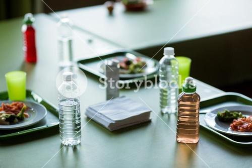 Food with water bottles on table