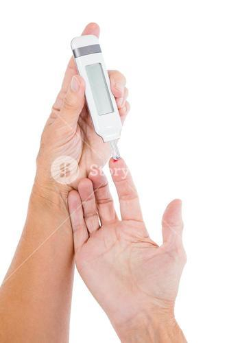 Cropped image of diabetic mature woman taking blood sample
