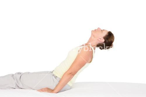 Calm woman exercising on bed