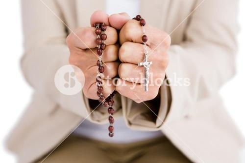 Woman holding rosary beads