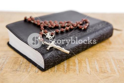Close-up of bible and rosary beads