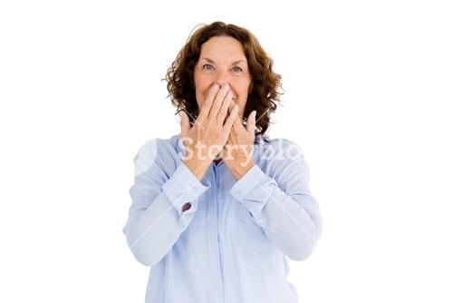 Portrait of smiling woman with hands covering mouth