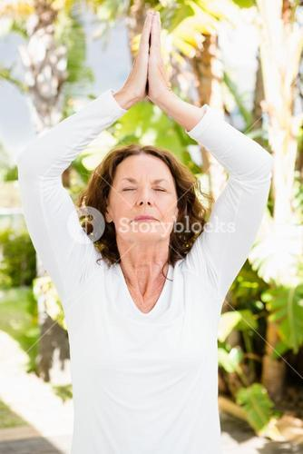 Woman with eyes closed while practicing yoga
