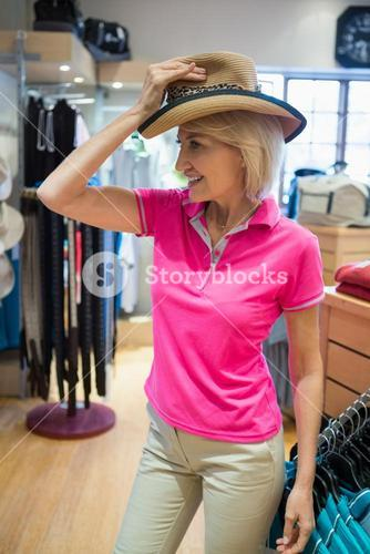 Mature woman trying on a hat
