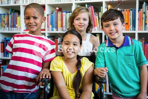 Handicapped girl with friends at library in school