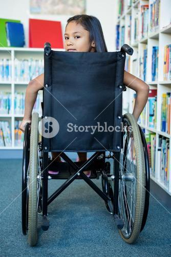 Portrait of handicapped girl at school library