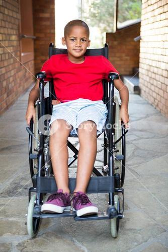 Handicapped boy at school corridor