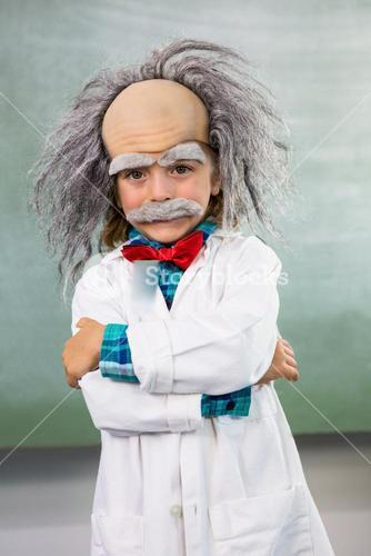 Smiling boy dressed as scientist standing with arms crossed