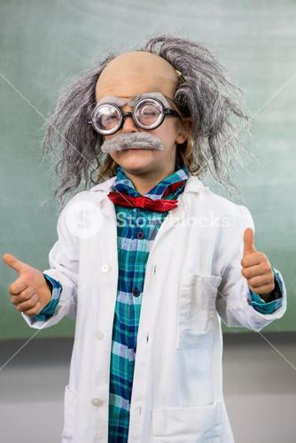 boy dressed as scientist gesturing thumbs up sign