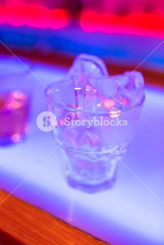 Ice cubes in glass of drink