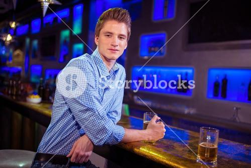 Portrait of man at bar counter