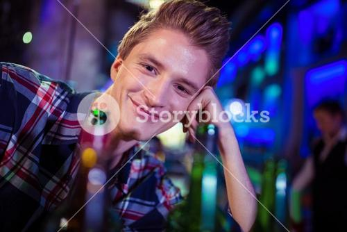 Portrait of smiling man at bar counter