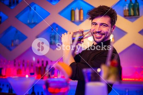 Handsome barkeeper preparing cocktail