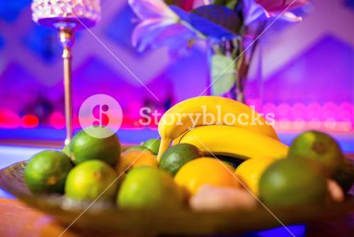 Fruits in plate on bar counter
