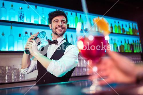 Barkeeper preparing cocktail for customer