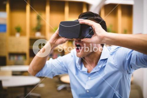 Businessman enjoying augmented reality headset at office