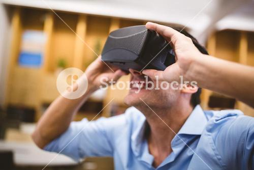 Close-up of businessman enjoying augmented reality headset at office
