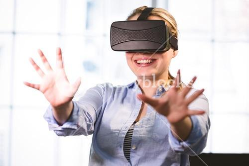 Woman enjoying virtual reality headset