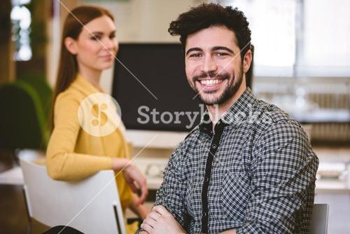 Happy businessman with female coworker