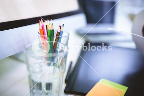 Desk organizer with drinking glass and graphics tablet