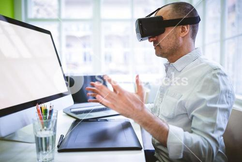 Graphic designer using virtual reality headset