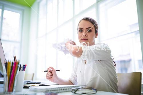 Angry graphic designer throwing paper
