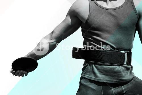 Composite image of close up on sportsman chest practising discus throw