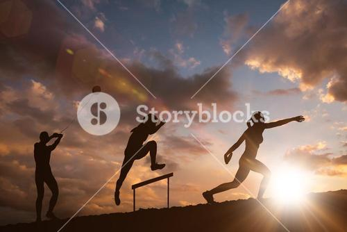 Composite image of profile view of sportswoman practising discus throw