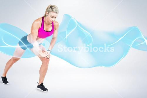 Composite image of female athlete stretching and listening music