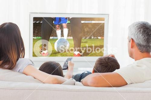 Composite image of family sitting on sofa watching television together