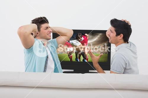 Composite image of disappointed soccer fans watching tv