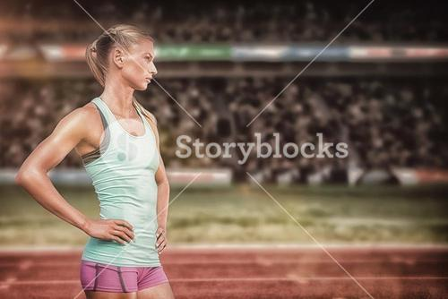 Composite image of profile view of sportswoman standing on a white background