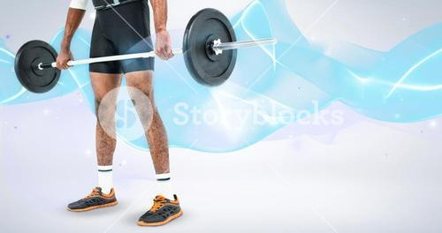 Composite image of mid-section of bodybuilder lifting heavy barbell weights
