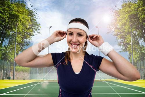 Composite image of female athlete wearing headband and wristband