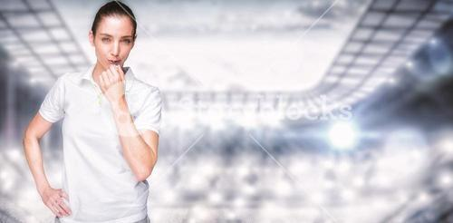 Composite image of female athlete blowing a whistle