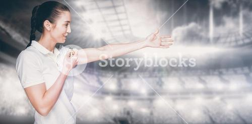 Composite image of female athlete blowing a whistle and pointing