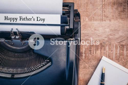 Happy fathers day written on paper