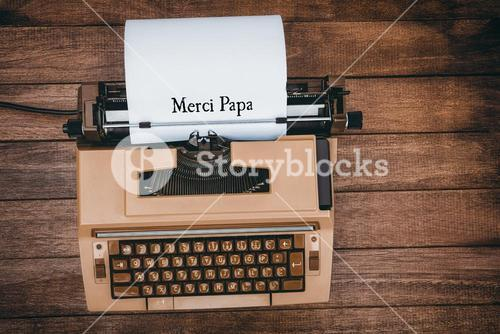 Merci papa written on paper