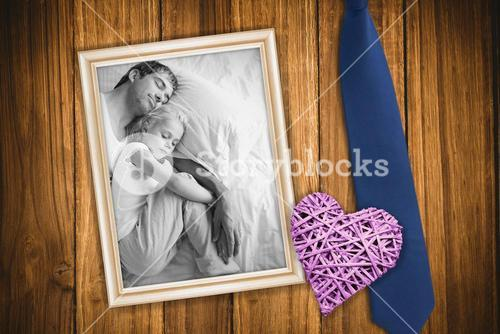 Composite image of father and daughter sleeping on bed