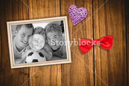 Composite image of portrait of smiling son, father and grandfather on floor