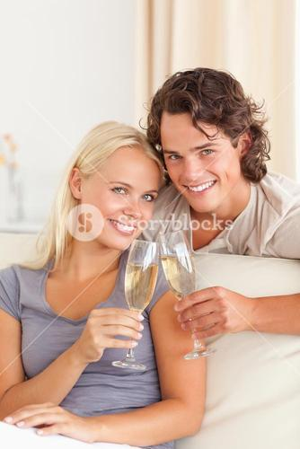 Portrait of a young couple making a toast