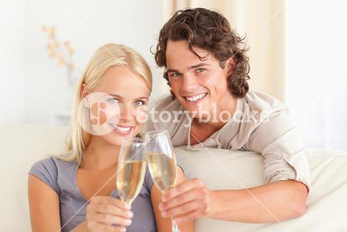 Lovely couple making a toast