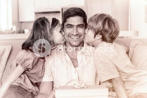 Children kissing on fathers cheeks