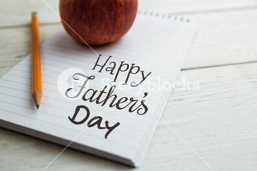 Happy fathers day written on notebook