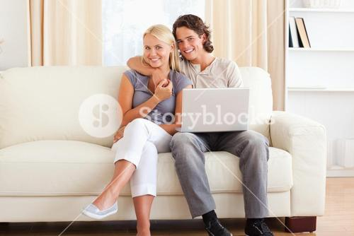 Friendly couple with a laptop